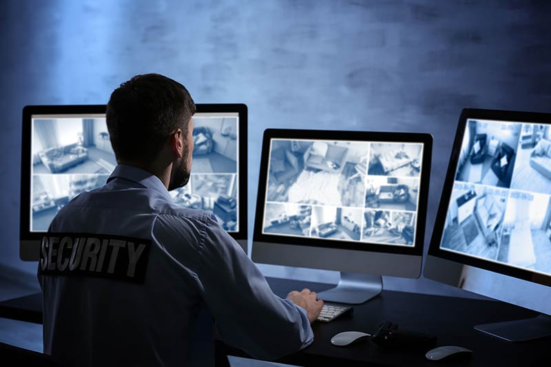 Security Officer Watching Cameras